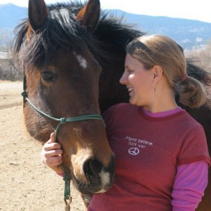 (2008) Stacey Couch with her first horse, Cherokee, an abused mustang that Stacey rescued and rehabilitated.